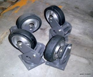 LAIRD INC R2368 T SHOCK ABSORBING SPRING LOADED CASTERS, LOT OF 4