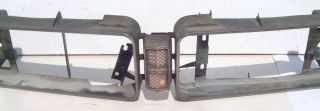 This is an original grill surround set with center emblem for 1971