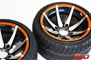 rims wrapped into low profile racing tires. Size 235/30 12. These are