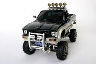 Tamiya 58397 1 10 Toyota Hilux High Lift 4x4 3spd New in Box