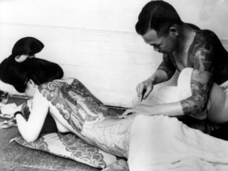 An Unidentified Japanese Tattoo Artist Works on a Womans Backside Photographic Print