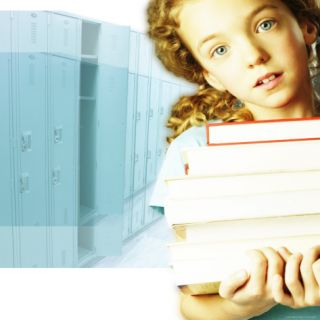 Young Girl Carrying Books Photographic Print