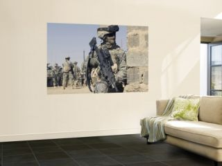 Us Army Soldier Armed with a Mk 48 Light Machine Gun, Provides Rear Security During Civil Affairs Wall Mural