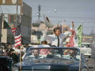 Republican Gubernatorial Candidate Ronald Reagan Waving in Convertible Car While on Campaign Trail Premium Photographic Print by Bill Ray