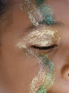 A Child Sports Glitter Face Paint During the Annual Notting Hill Carnival Photographic Print by Jodi Cobb