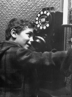 4 Year Old Boy Calling Santa Claus from a Pay Phone Premium Photographic Print by Martha Holmes