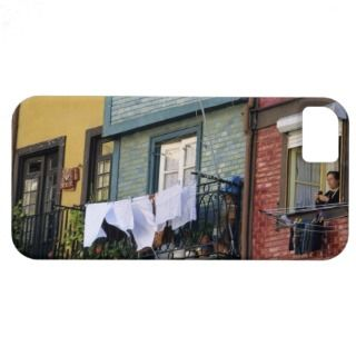 Portugal, Oporto (Porto). Woman hanging laundry iPhone 5 Cases