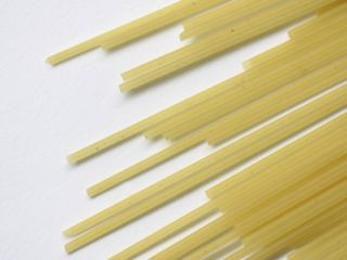 Uncooked Pasta Spaghetti Noodles on a White Counter Photographic Print