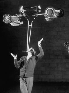 Robert Dotzauer Balancing Lawn Mowers Weighing a Total of 145 lbs on His Chin Premium Photographic Print by Ralph Crane