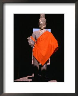 Standing Buddha statue in orange cloth, in outer gallery at Angkor Wat, Angkor, Cambodia Pre made Frame