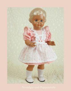 Schildkrötpuppe Erika, 64 cm, blond, blaue Augen, im rosa weißen