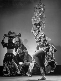 Dancer Katherine Dunham Dancing Barefoot with Cigar in Her Mouth and Birdcage Balanced on Her Head Premium Photographic Print by Gjon Mili