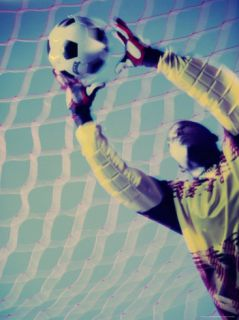 Low Angle View of a Goalie Catching a Ball Photographic Print
