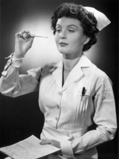 Nurse Reading Thermometer Photographic Print by George Marks