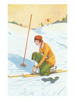 Lady Skier Adjusting Skis Posters