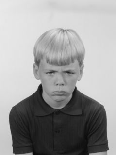 Studio Shot of Boy With Facial Expression Photographic Print by George Marks