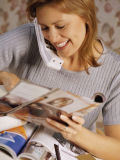 Woman Talking on Cordless Phone and ing at Photographs Photographic Print