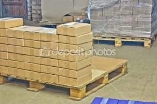 Cardboard boxes on wooden palette  Stock Photo © Natalija Gagarina