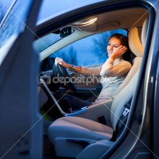 Pretty young woman driving her brand new car  Foto Stock © lightpoet