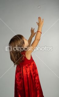Little girl in a red dress with hands up  Stock Photo © Viktoria