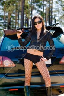 Girl with gun  Stock Photo © Alexander Podshivalov #1417715