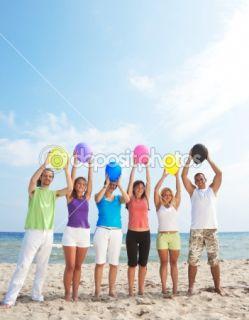 Happy people holding balloons  Stock Photo © Igor Mojzes #1809720